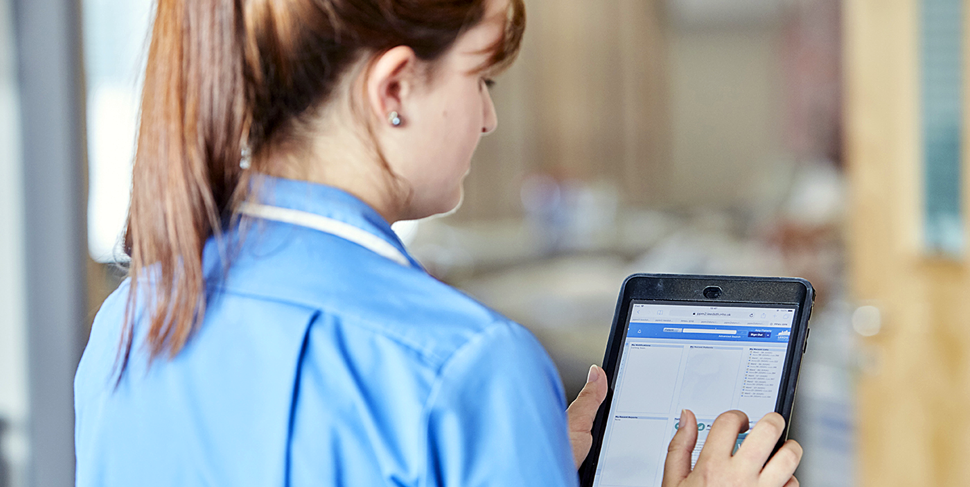 A nurse checks out additional information on a patient's Summary Care Record.