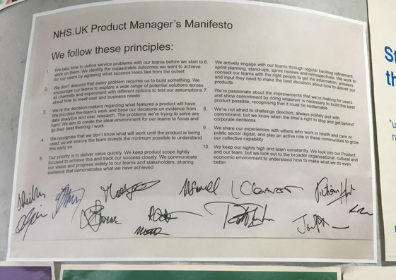 A photograph of a printed out 'manifesto' signed by all contributors in marker pen