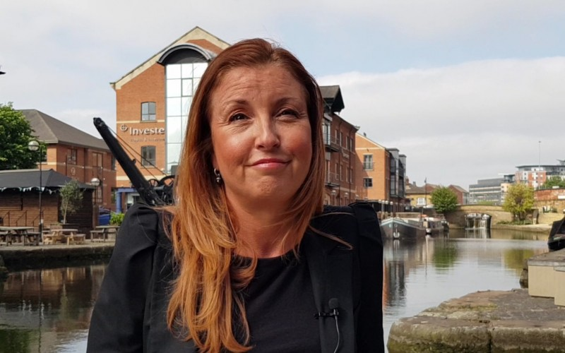 Tracey Watson head and shoulders shot standing by canal